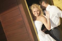 Lovely bride saying good bye near door after wedding. Stock Photos