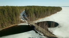 Melt ice around a country road bridge with springtime lake landscape Stock Footage