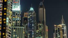 Close View of Dubai Marina Towers in Dubai at night timelapse hyperlapse Stock Footage