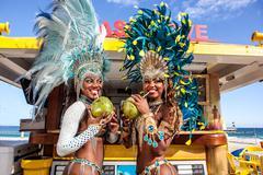 Two samba dancers drinking coconut drinks, Ipanema Beach, Rio, Brazil Kuvituskuvat