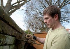 Bricklayer applying mortar Stock Photos