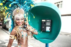Samba dancer using pay phone, Ipanema Beach, Rio De Janeiro, Brazil Kuvituskuvat