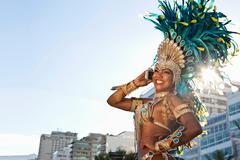 Samba dancer using cellphone, Ipanema Beach, Rio De Janeiro, Brazil Kuvituskuvat