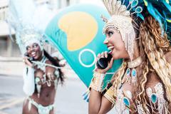 Samba dancers using pay phones, Ipanema Beach, Rio De Janeiro, Brazil Kuvituskuvat