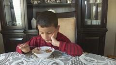 Boy Eats Breakfast Cereal - stock footage