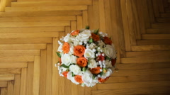 Wedding bouquet on the floor - stock footage