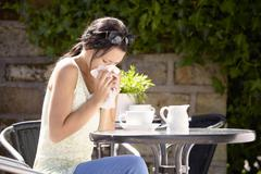 Woman suffering from hay fever Stock Photos