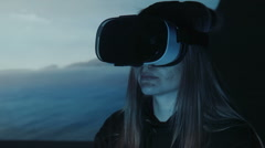 Woman watching film in oculus rift Stock Footage