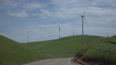 Three turbines near a road in a Californian wind farm Stock Footage