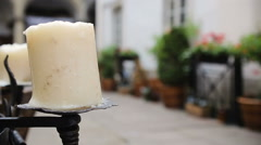 Big white burning candle in woman hands Stock Footage