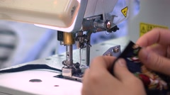 Factory seamstress at work and industrial sewing machine 4K - stock footage