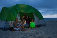 Family with four children in tent on Huntington Beach, California, USA Stock Photos
