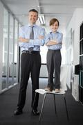 Father and son in office, boy standing on chair Kuvituskuvat
