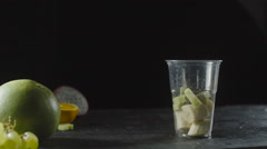 Pineapple Slices Add a Fruit Cocktail Cup Stock Footage