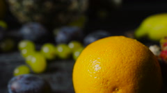 Pomelo Fruit and Orange on Dark Wooden Table Stock Footage