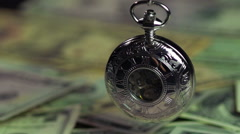 Silver pocket watch and dollars, time is running out like money. Time management - stock footage