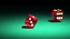 Red casino dice rolling on green table in slow motion, chances to win, gambling - stock footage