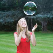 Girl playing with bubble Stock Photos