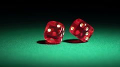 Macro view of red casino dice rolling on table, success and luck in human life Stock Footage