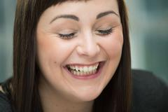 Young woman laughing, eyes closed Stock Photos