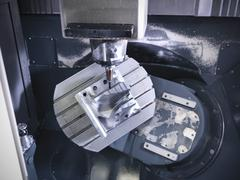 Complex steel part on computer numerical controlled, CNC, lathe in factory Kuvituskuvat