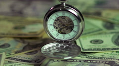 Watch and money closeup, the pendulum of fate. Importance of time over finances - stock footage