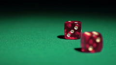 Dice decide destiny, red cubes falling on casino table in slow motion. Gambling Stock Footage