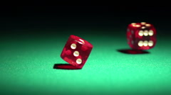Red casino dice rolling on green table in slow motion, chances to win, gambling Stock Footage