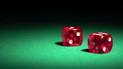 Rolling dice in slow-motion. Gambler enjoying the chance to win a game in casino Stock Footage