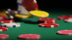 Many poker chips falling on green casino table, gambler winning the super prize Stock Footage