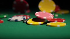 Lots of poker chips falling on casino table in slow-mo, lucky winner at casino Stock Footage