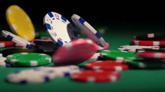 Colored chips falling on the green poker table. Successful player winning game Stock Footage