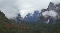 Time lapse of storm rolling into Yosemite Valley Stock Footage