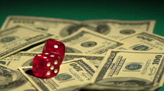 Dice falling on money, odds to win. Stock exchange gambling, risky investments Stock Footage