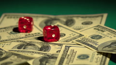Dice rolling on money, risky financial investments, stock exchange gambling Stock Footage