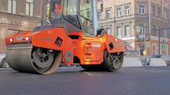 RUSSIA ST.PETERBURG- Road workers laid asphalt, repairing the road in Stock Footage