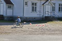 Boy riding bicycle pulling bunting Stock Photos