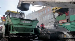 RUSSIA ST.PETERBURG- Road workers laid asphalt, repairing the road in Stock Footage