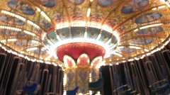 Out of focuse whirling empty carousel with blinking lights Stock Footage