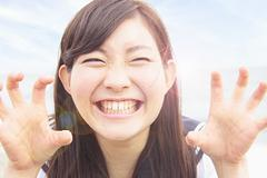 Young woman pulling funny face and hands like claws Stock Photos