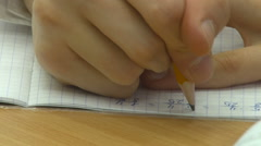 Hand Writing in Notebook With a Pencil and Pen. Solve Mathematical Example. - stock footage