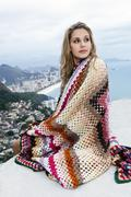 Young woman wrapped in wool blanket, Casa Alto Vidigal, Rio De Janeiro, Brazil Stock Photos
