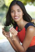 Portrait of young woman holding coffee cup Stock Photos