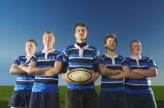 Portrait of rugby team, one man holding ball Stock Photos