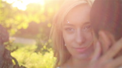 Sensual beautiful dreamy young blonde bride and handsome groom at sunset in the - stock footage