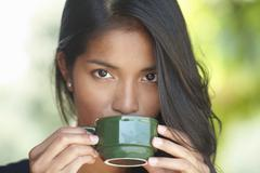 Portrait of young woman drinking coffee Stock Photos