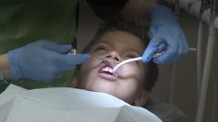 Dentist Suction On Kid Stock Footage