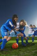 Young women playing football Kuvituskuvat