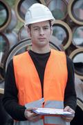 Manual worker wearing high vis vest and hard hat Stock Photos
