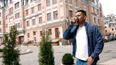 Young handsome man with coffee cup in London city Stock Footage